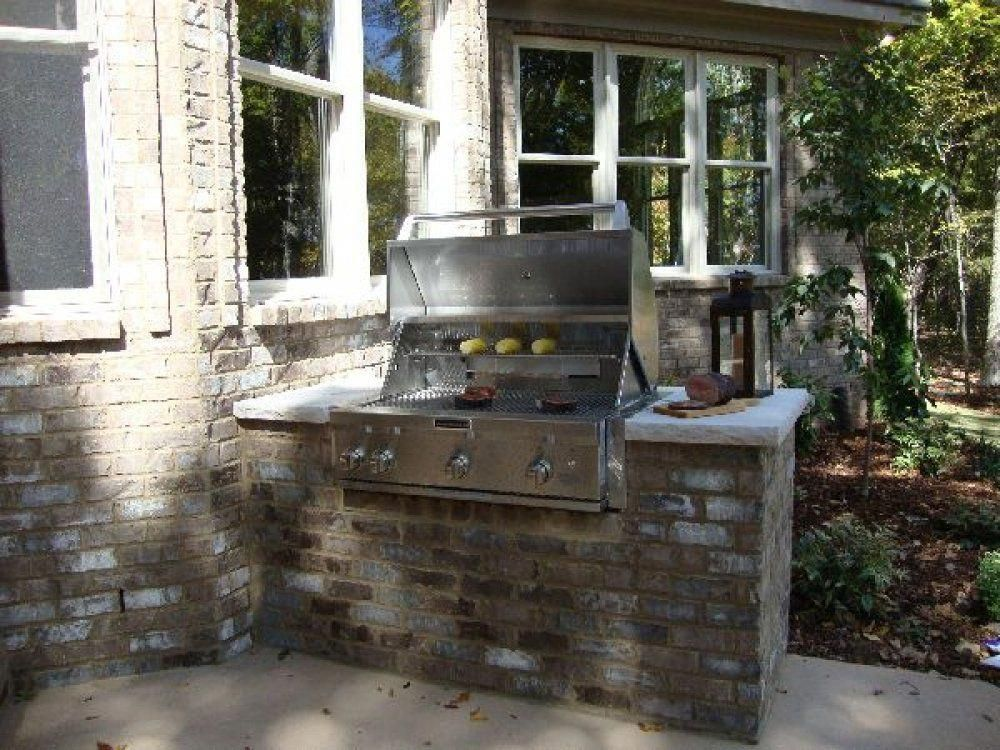 Here S A Small Built In Grill That Extends From The Brick Of House