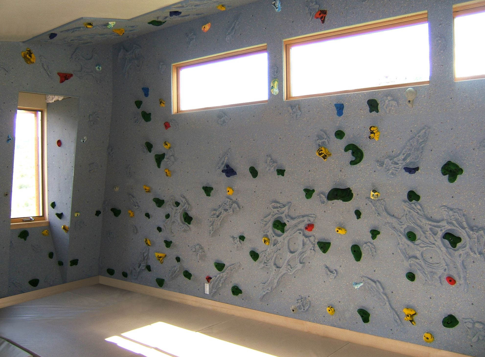 Beautiful home climbing wall built around windows and even for Home climbing