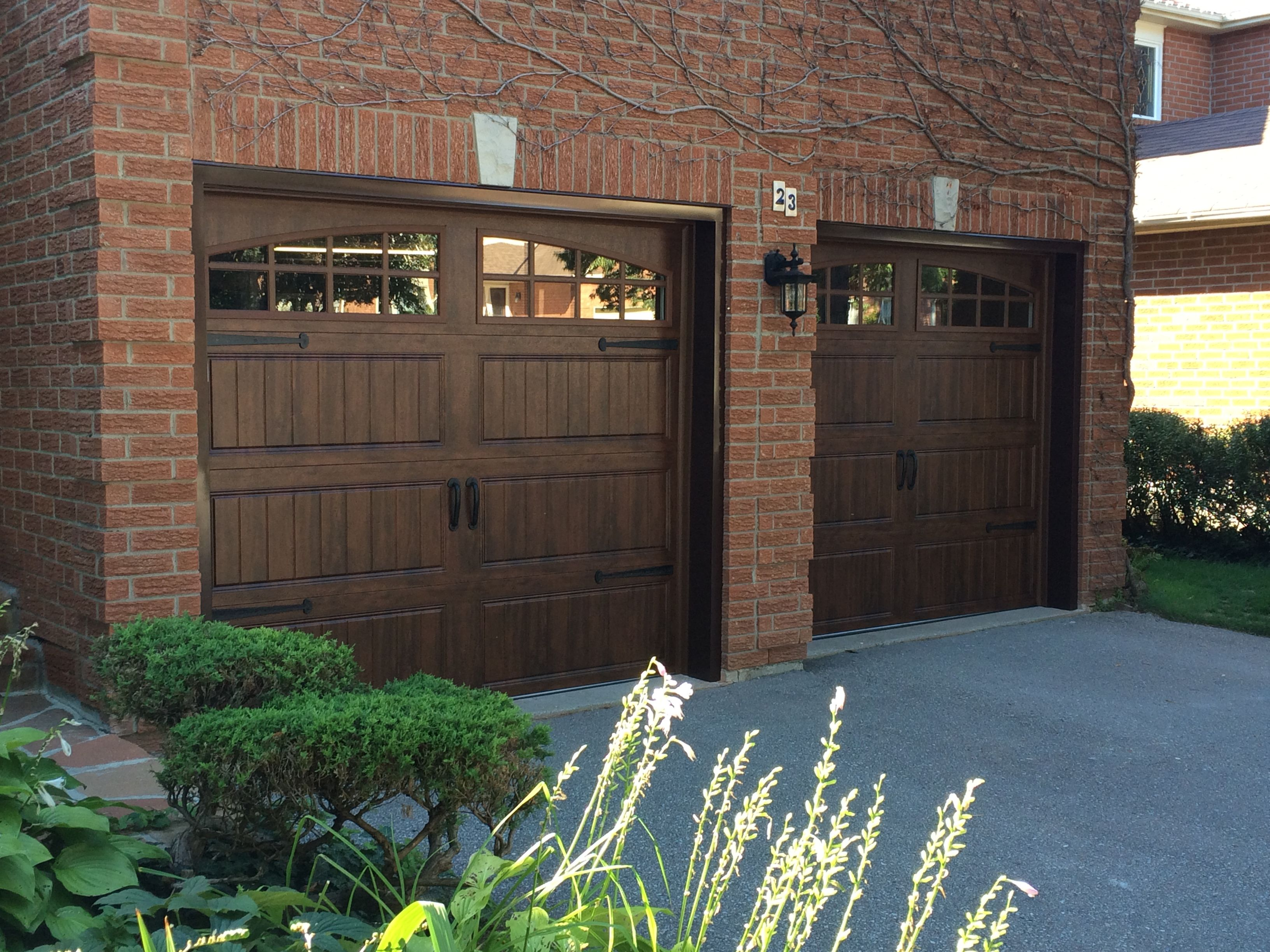 Beautiful Steel Insulated Doors With Clopay Ultra Grain Walnut Finish And Colonial Decorative Hardware Garage Doors Garage Door Styles Faux Wood Garage Door