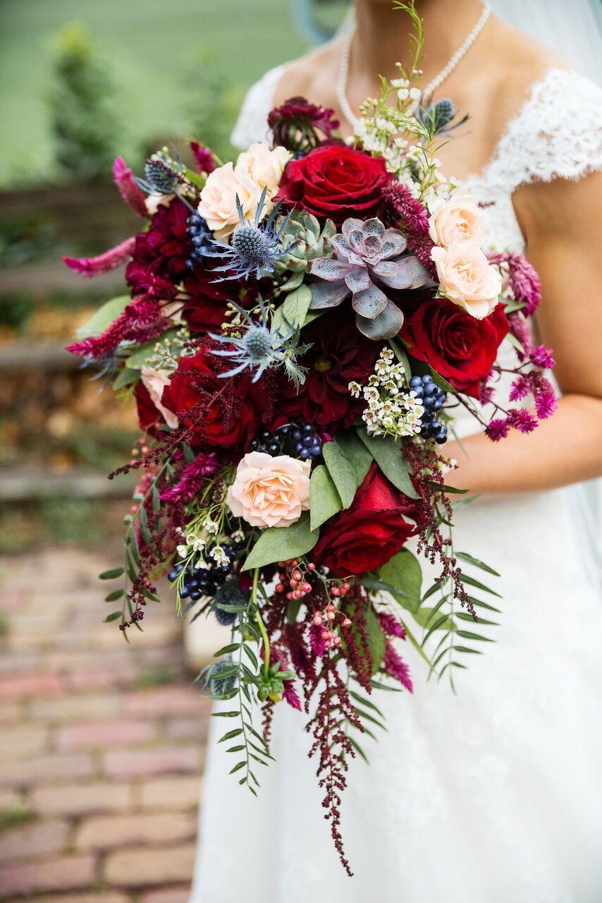 Cascading boho bouquet including pepper berries, succulents, blue ...