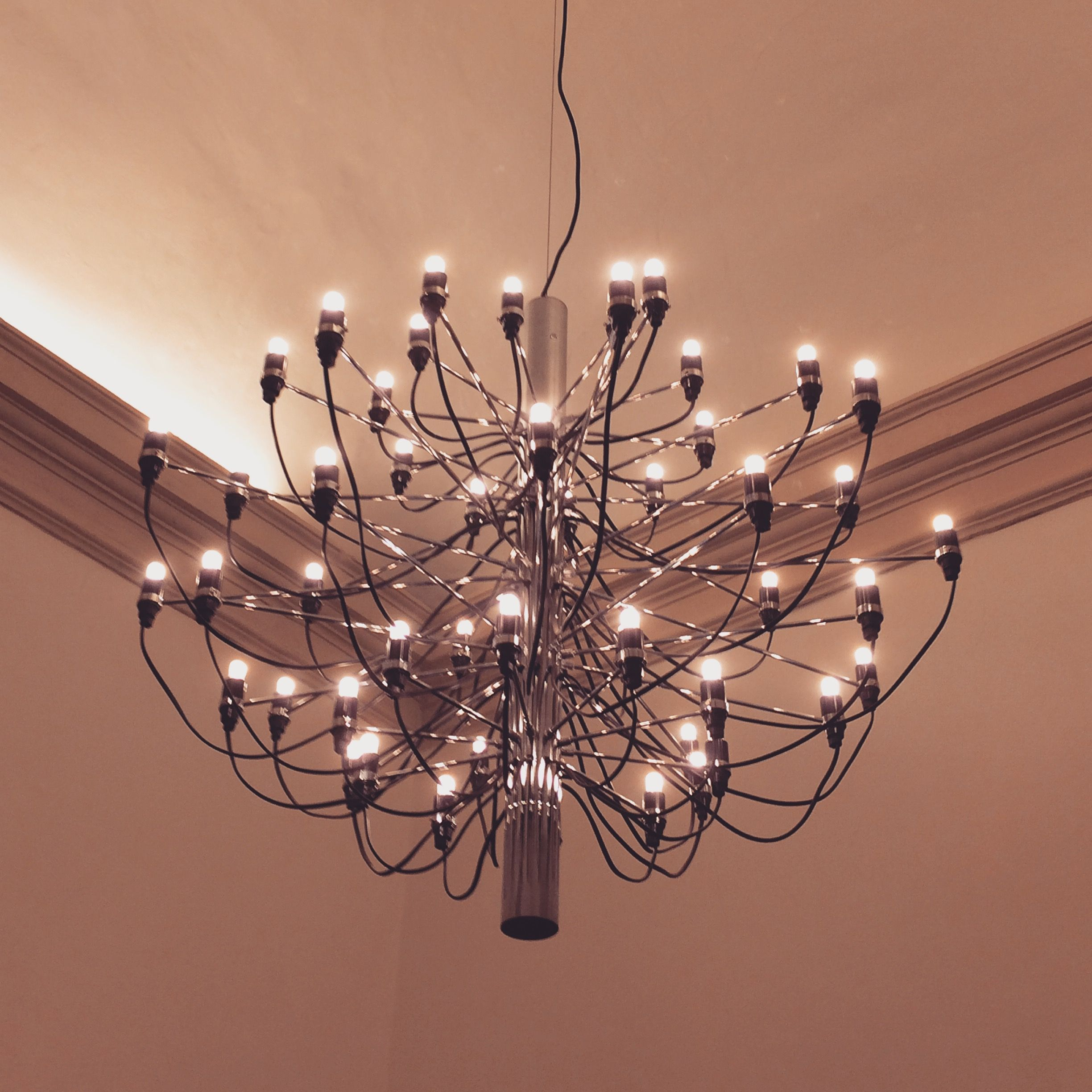 Gino Sarfatti's chandelier (designed in 1958) in a 18th century's 6 meters high italian room
