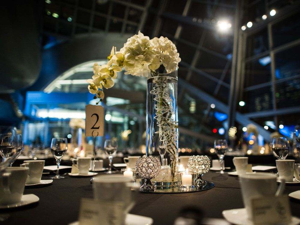 A Modern Winter Wedding In Alberta White Floral Centerpieces