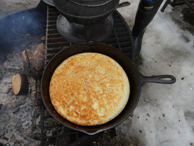 Bread made in a Cast iron pan on the open fire.