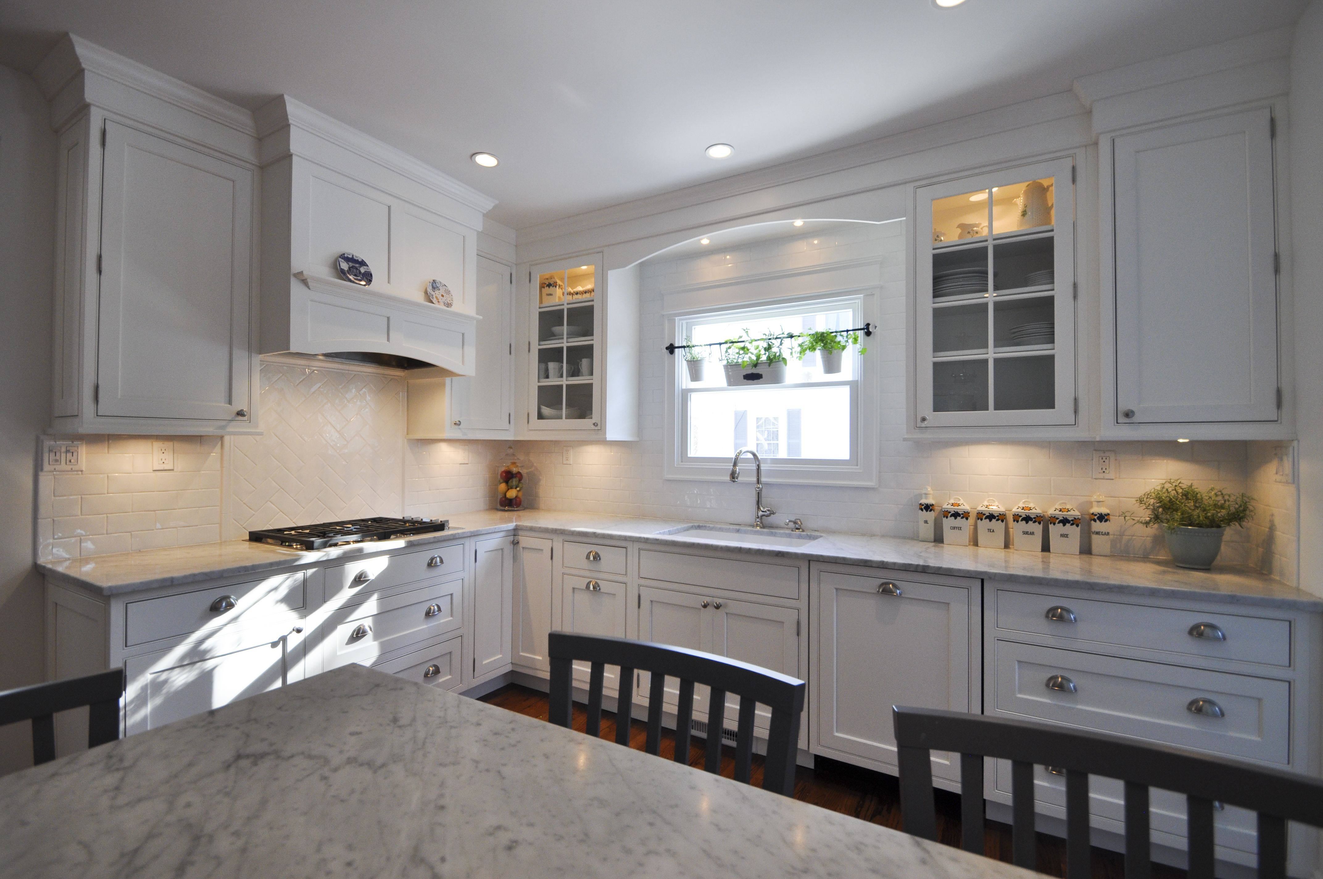 Simple Shaker Kitchen With Marble Counter Tops In Cabinet And Under Cabinet Lighting 3x6 Sub Way Tile Bac Kitchen Construction Kitchen Remodel Kitchen Design