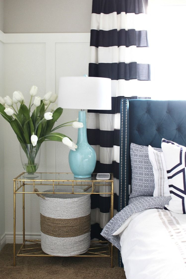 Bold Stripes and Shades of Blue make our guest bedroom the best room in our home!