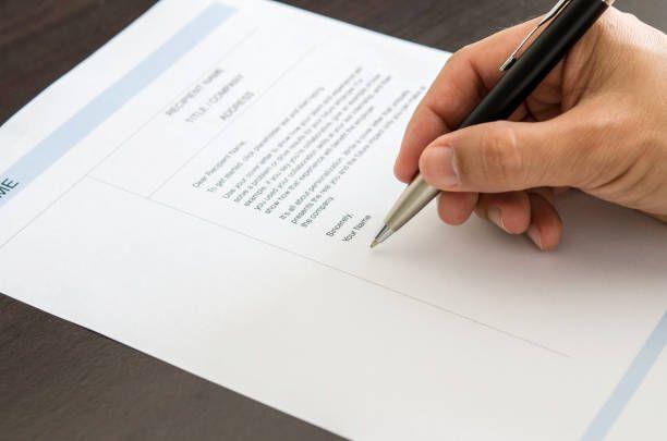 closeup businessman or job seeker signing on resume form hueputalo - resume form