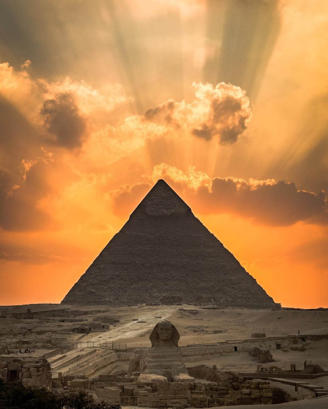 Sunset behind the Great Pyramid and Sphinx of Giza, Egypt