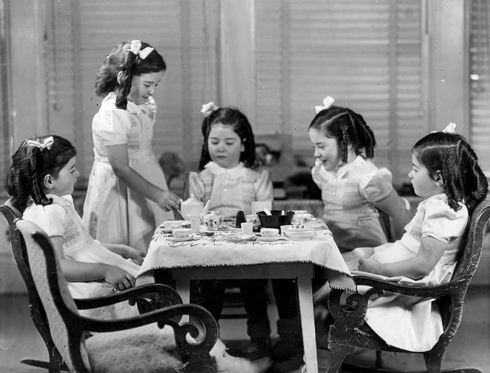 1940: The Dionne quintuplets have a tea party in the ...  1940: The Dionn...