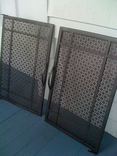 Added decorative grates to my fireplace doors.