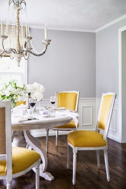 Bright Yellow Chairs In A Gray Dining Room