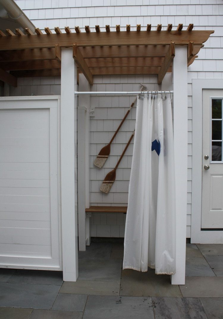 gorgeous private outdoor shower boasts stunning teak outdoor gorgeous private outdoor shower boasts stunning teak outdoor flooring and white wood panel walls supporting a large brass overhead gooseneck sho