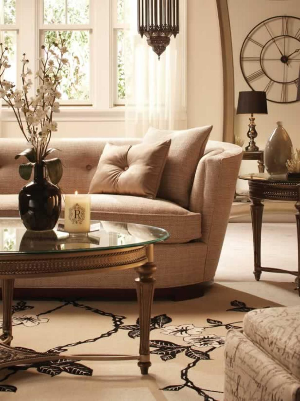 This Living Room Space Has A Round Glass Coffee Table Floral Area