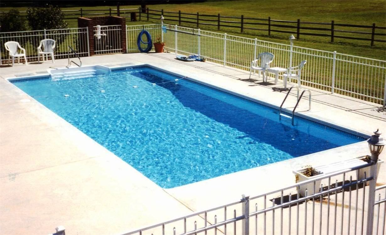 swiming pools fiberglass in ground pools with plastic patio chairs