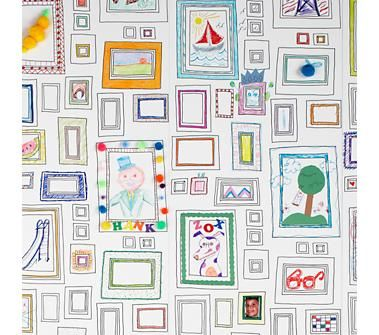 Frames wall paper to draw on. Super cool!