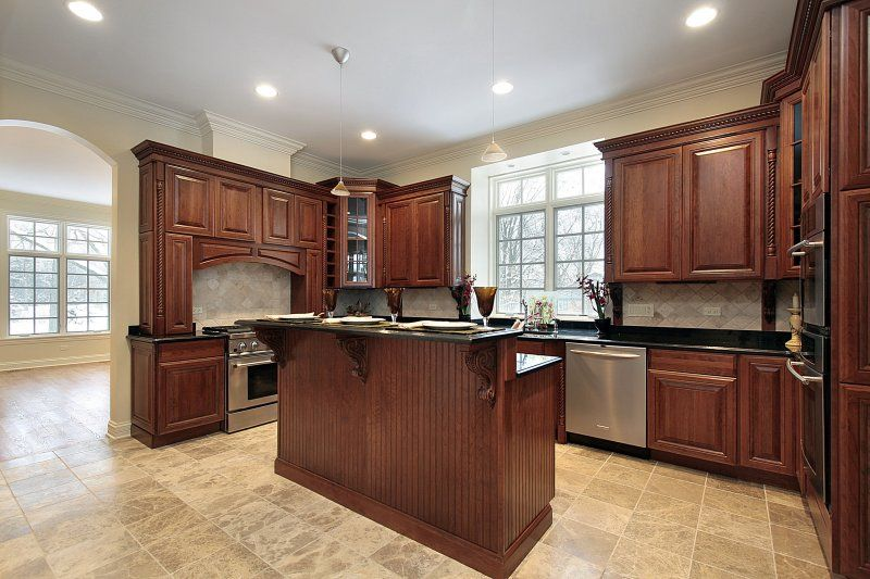 Medium dark cabinets with dark countertops middle island for Kitchen ideas for medium kitchens