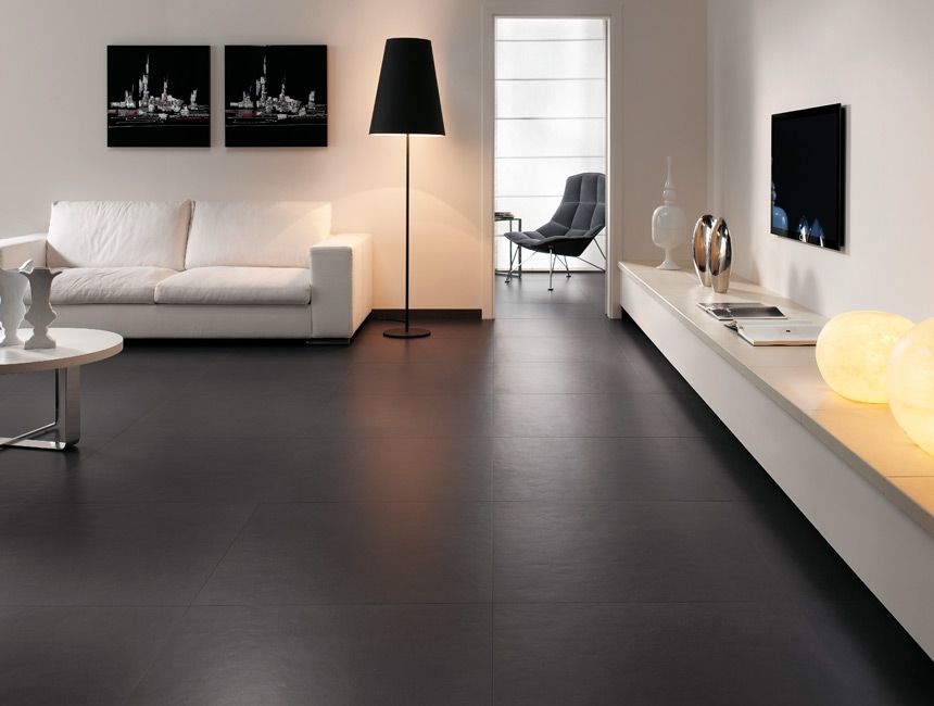 Modern But Comfortable Dark Floor Tile Lends Style To Living Rooms