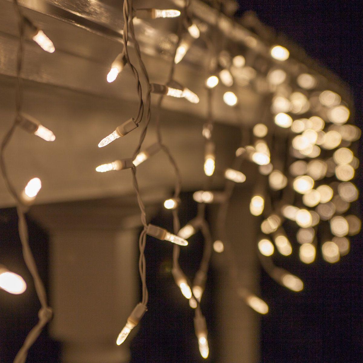 White icicle lights for christmas hang across the roof porch or white icicle lights for christmas hang across the roof porch or fence plus aloadofball Image collections