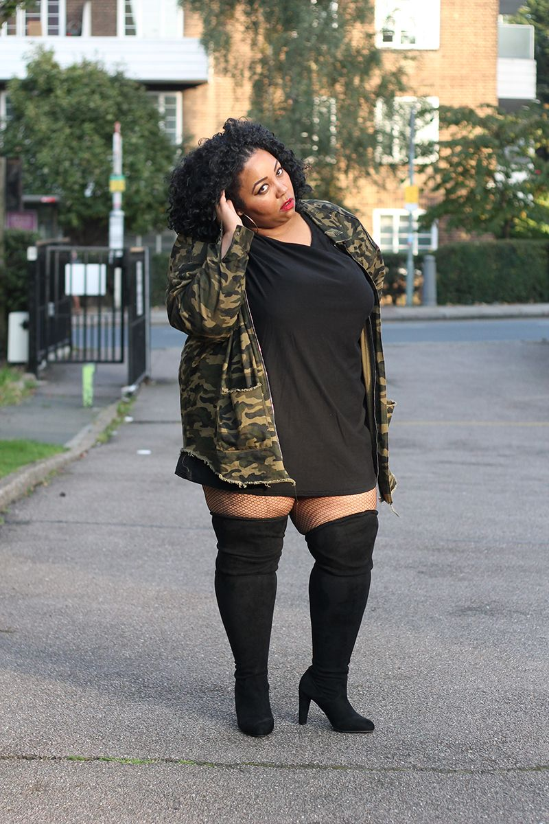 4dc23360637 a plus size woman wearing an oversized camouflage jacket