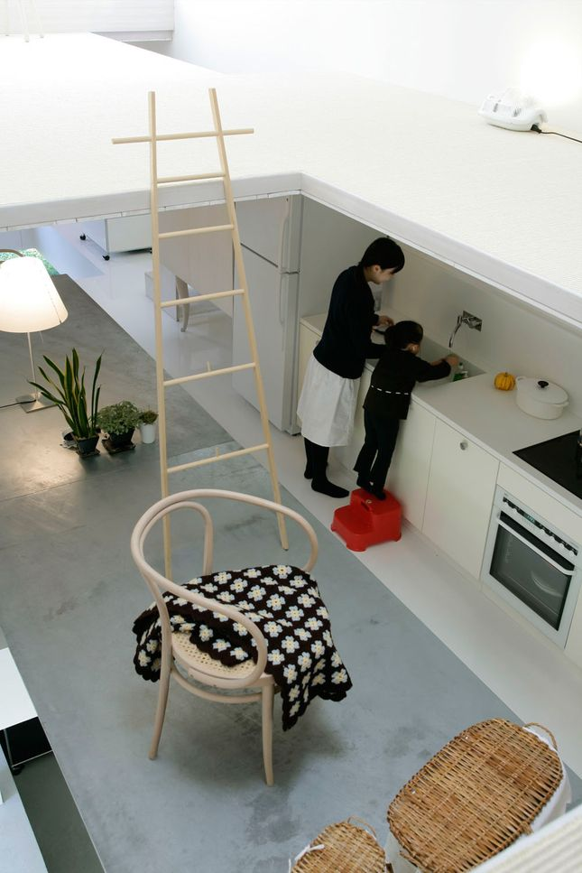 Furniture and goods placed on top of the table turn it into a floor slab hovering between the living floor and upper floor in Hideyuki Nakayama's '2004' house. | Read more: http://www.dwell.com/articles/Hideyuki-Nakayamas-2004-House.html