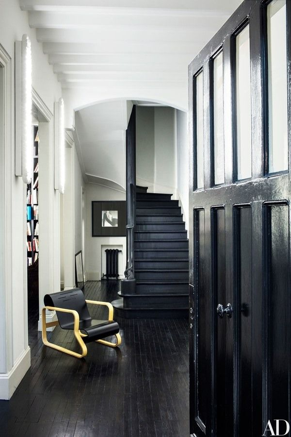 An Alvar Aalto chair sits in the entrance hall   archdigest.com