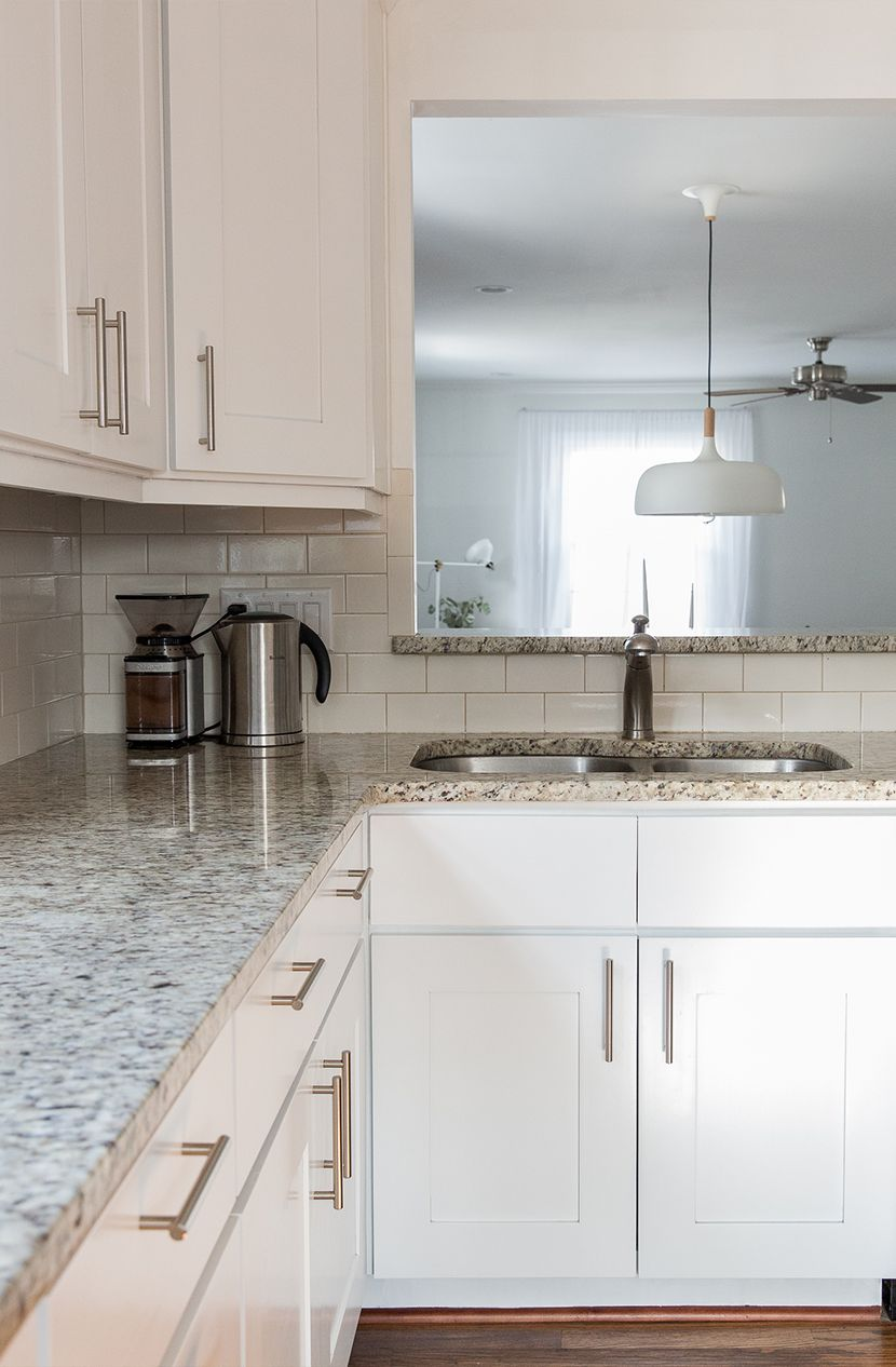 Elegant Gray Granite Countertops with White Cabinets