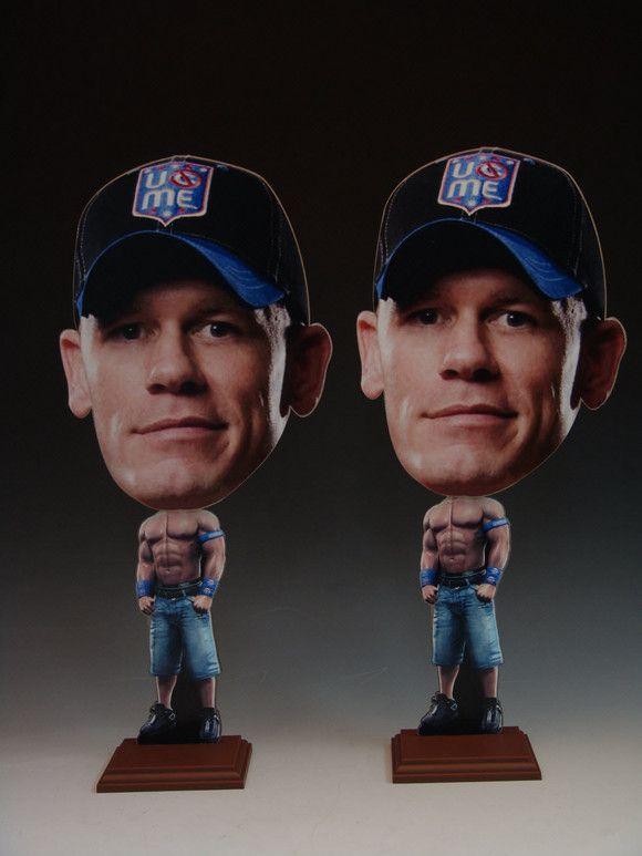 John Cena Wobblehead as sold by WWE store     http://shop.wwe.com/The-Rock-Wobblehead/35497,default,pd.html