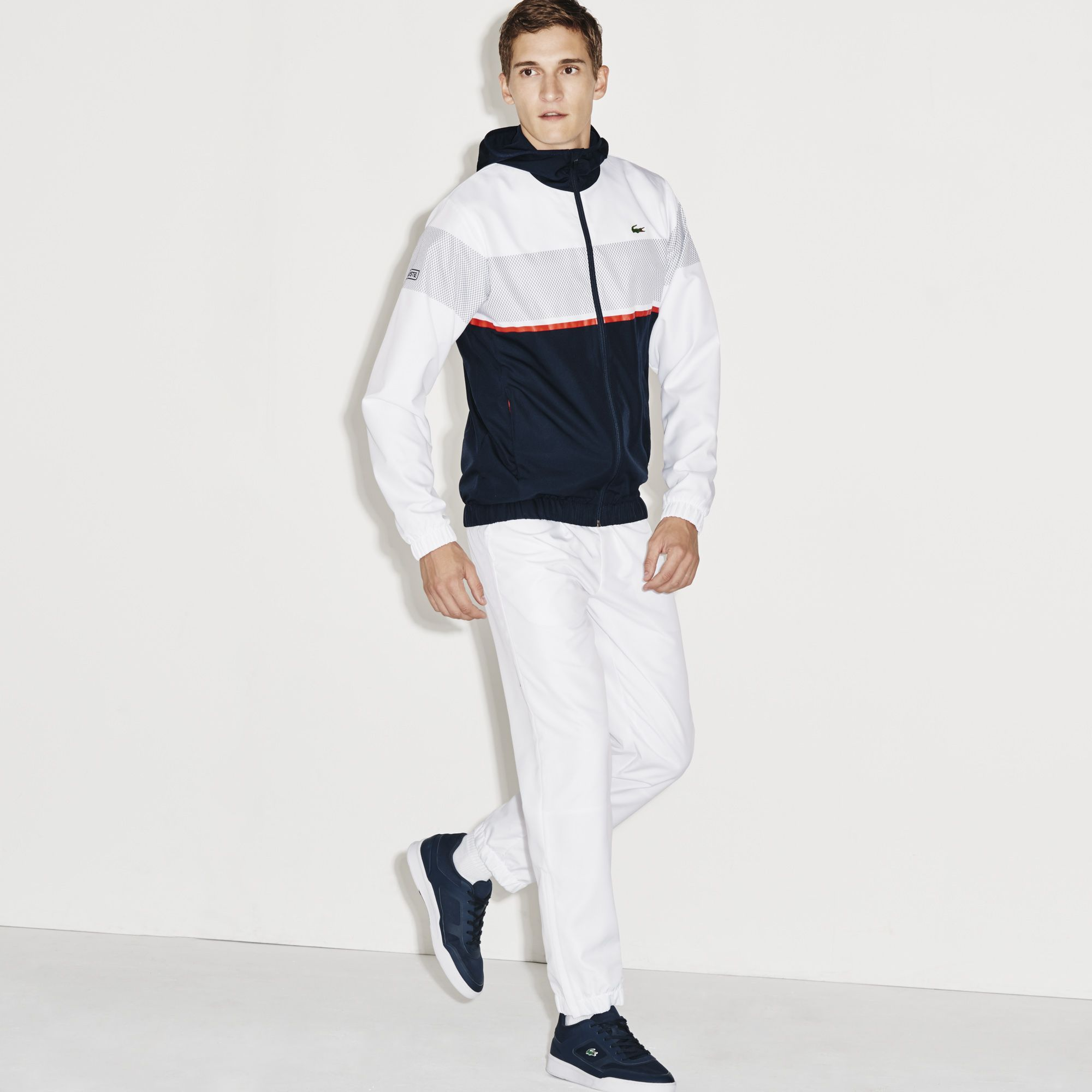 Shiny Taffeta Colorblocks Take On A Net Print For The Design Of This Tracksuit Because Somet Survetement Lacoste Homme Survetement Lacoste Vetements De Tennis
