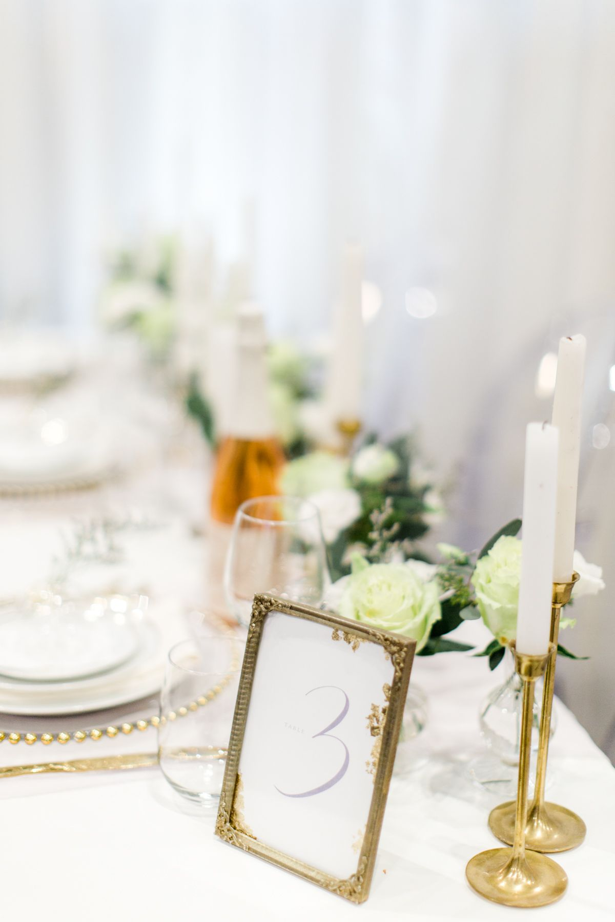 Wedding decor with ghost chairs  Brideus Wedding Show  via Elegant Productions  Modern Gold