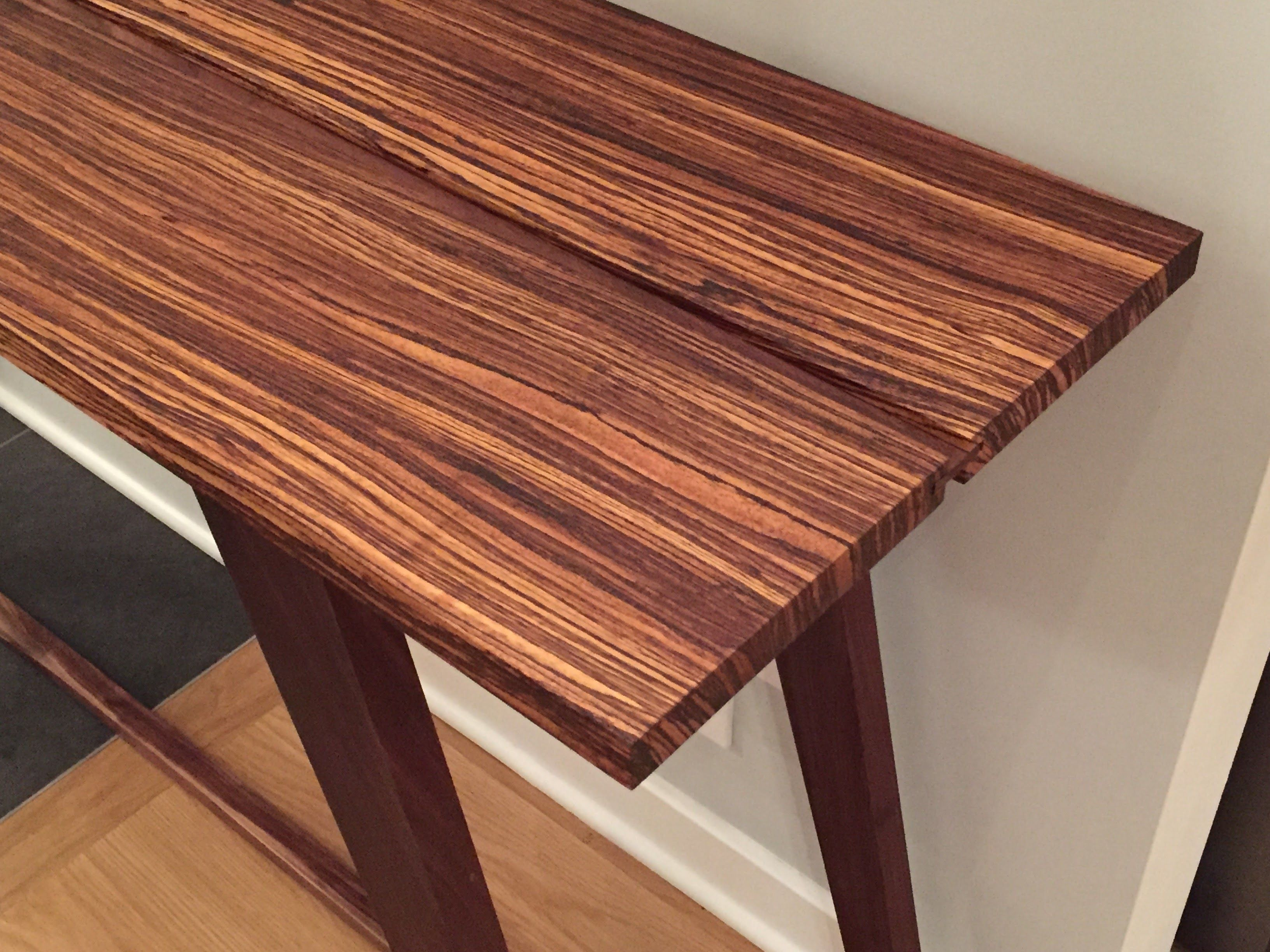 Zebrawood Top With A Black Walnut Spline For Expansion
