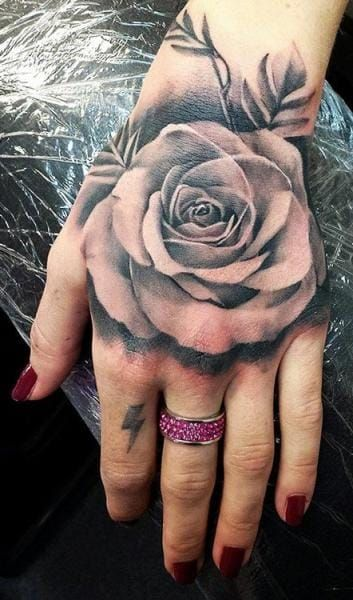 Rose Tattoos Meaning Placement Ideas Our Guide Rose Hand Tattoo Black And Grey Rose Tattoo Rose Tattoos