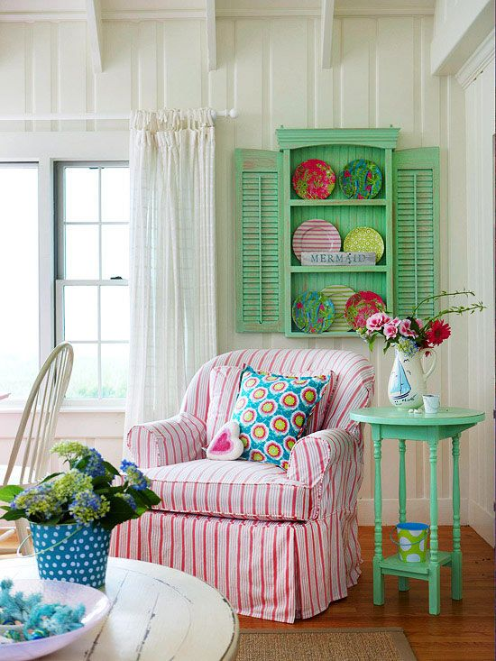 A playful color palette of seafoam green, turquoise, and pink brings youthful energy to this living room.