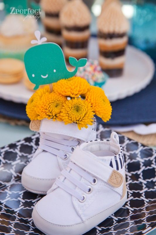 cute nautical baby shower centerpiece idea baby shoes with flowers in them
