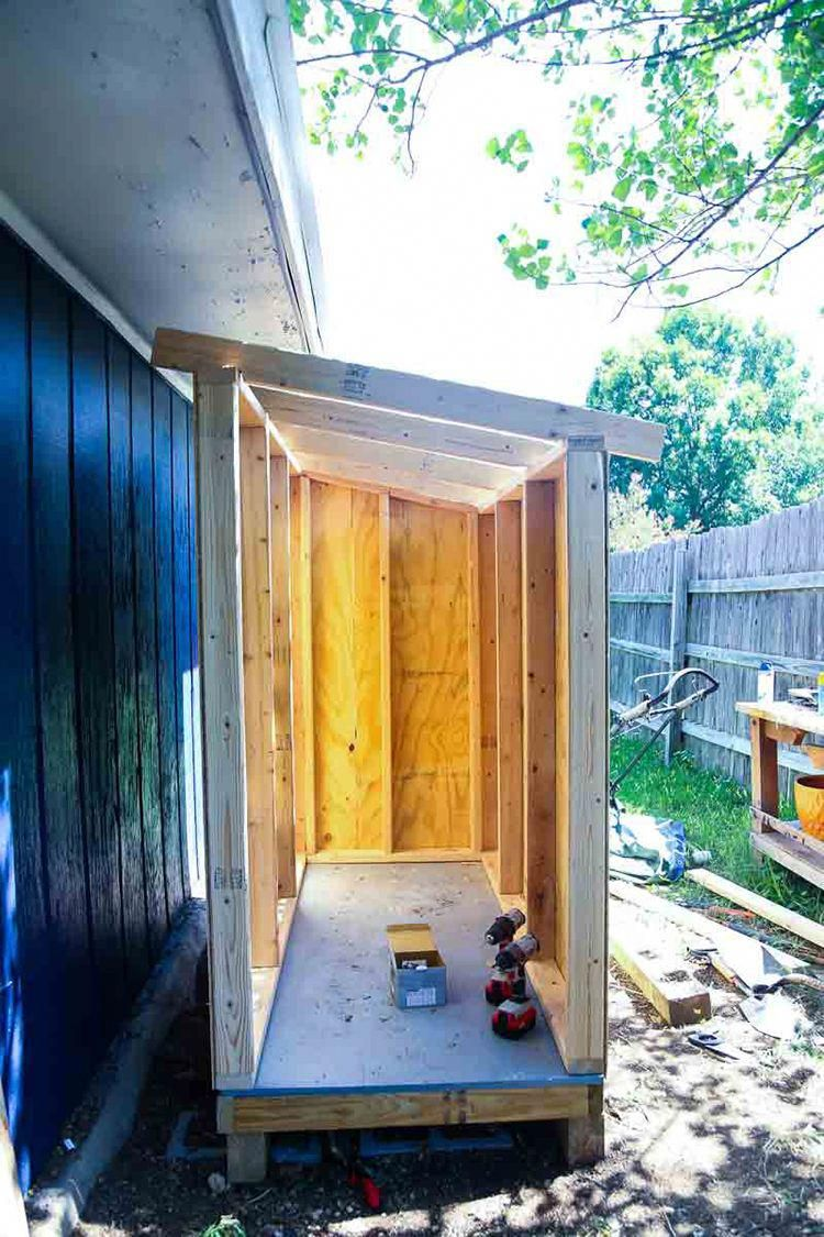 This small wooden shed is big enough to store a lawn mower ...