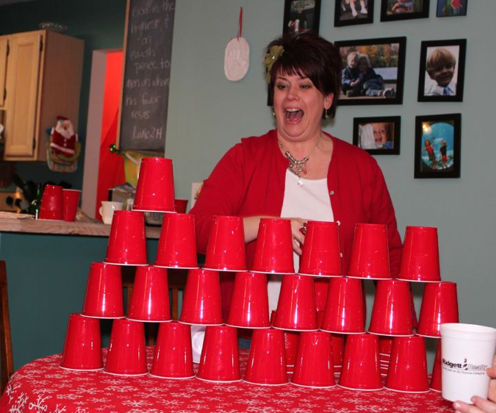 "Buy two bags of green cups. Which team can make the biggest ""Christmas tree"" in 60 seconds"