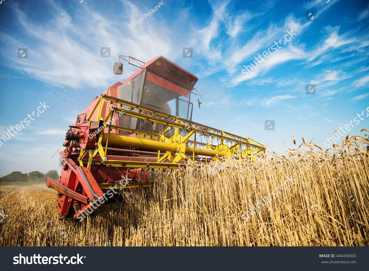 Close Up Of A Harvester Cropping The Field Sponsored