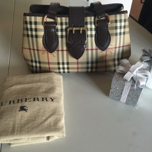 Burberry Nova Check Tote In excellent preloved condition. Corners are great no rips no rubbing. Small dirt in the interior. Comes with dustbag. 100% authentic Burberry Bags Totes