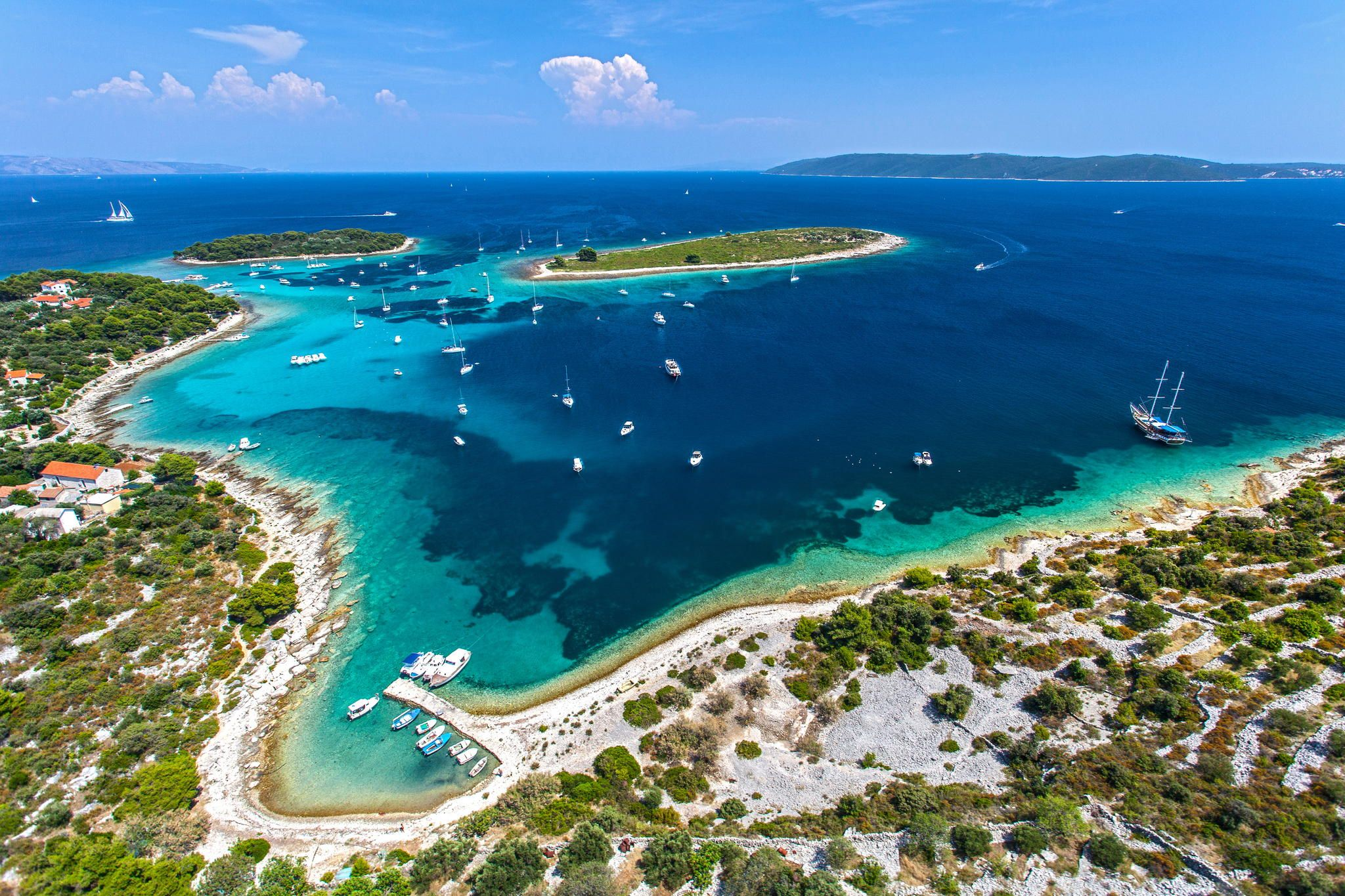 Bay with turquoise waters and sailboats at berth by Mario Jelavic on 500px