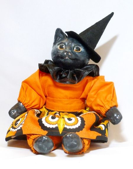 Bella. A black cat art doll. Portion of proceeds to