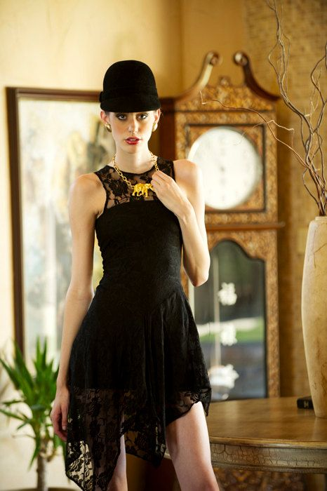 Asymmetrical black lace dress? Yes please. Gold elephant pendant? I think I will.