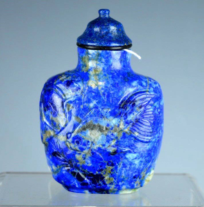 Well Carved Chinese Lapis Lazuli Fish and Lotus Snuff Bottle with matching Lapis Lazuil 'Officials Hat' top.