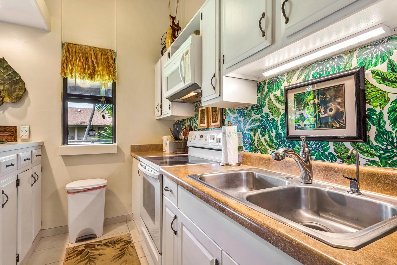 Fully stocked kitchen with new dishes aloha from mackallus makai
