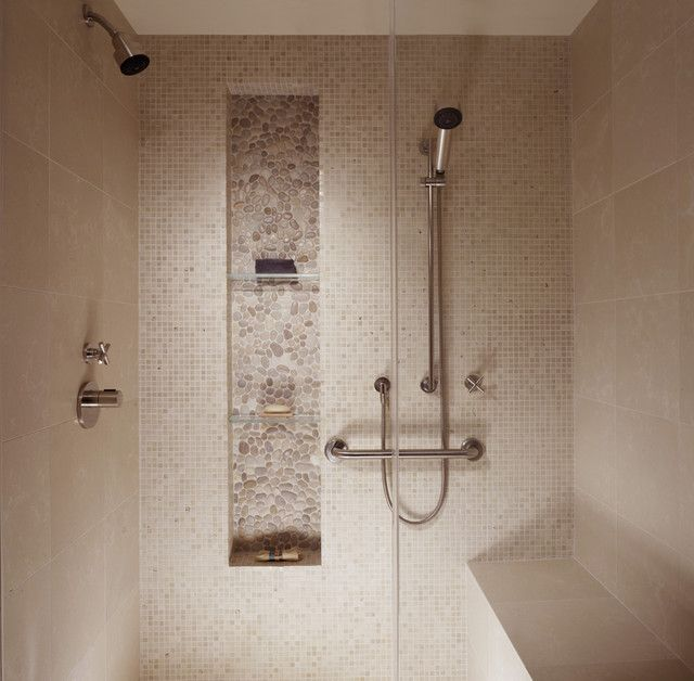 higher built in shelf for shower room with transparent glass panels a heldhand showerhead a permanent