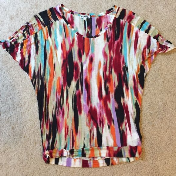 Express Multi Colored Shirt Express Multi Colored Shirt. EUC. Super soft, beautiful bright abstract print. Wish it still fit. No trades, use offer button to negotiate. Express Tops Tees - Short Sleeve