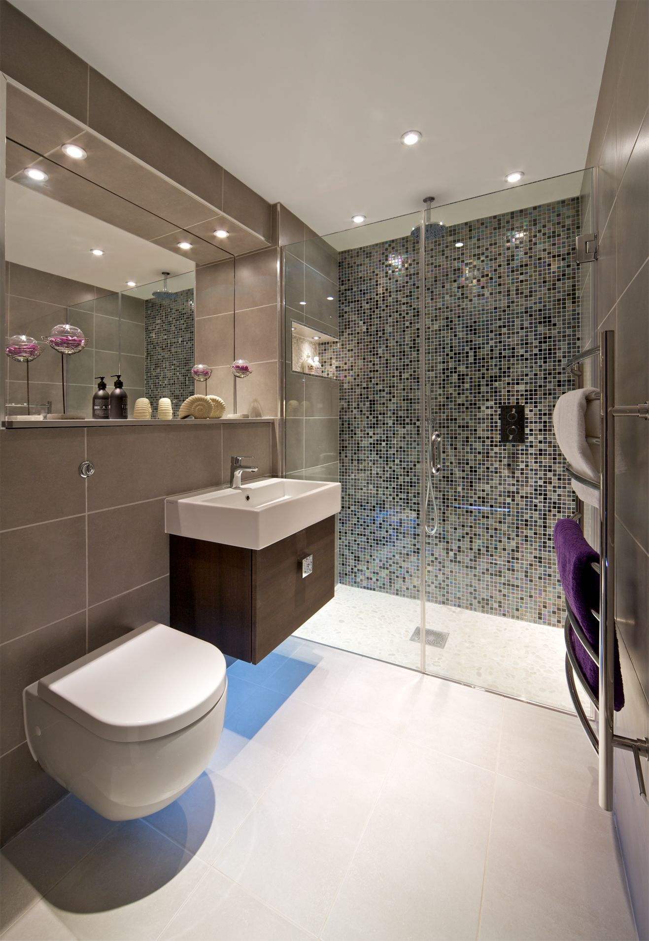 ensuite shower room with mosaic feature wall wall hung wc and