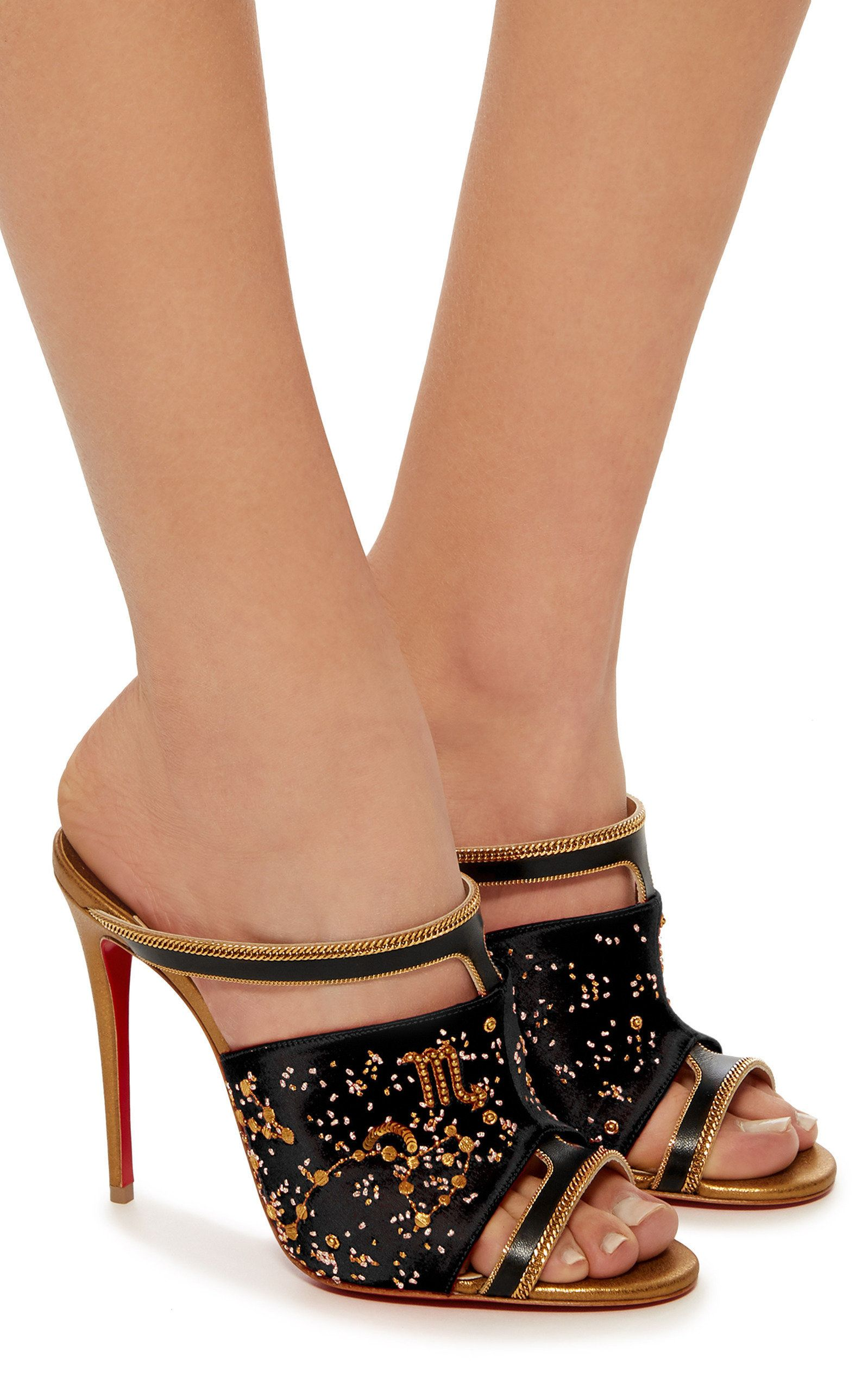 31f6552325b This limited edition M O Exclusive  Christian Louboutin mule is rendered in  satin and features an intricate embroidered detail and minimalist  silhouette.