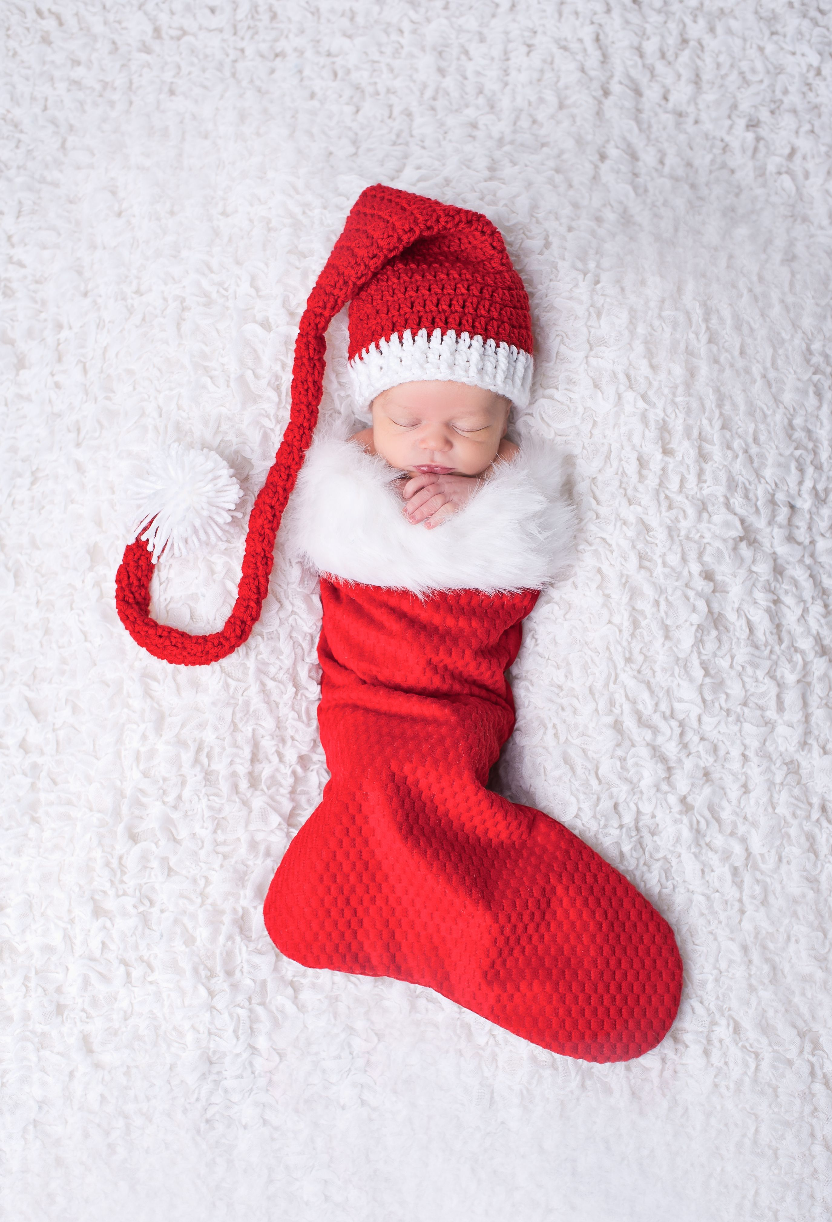 Baby in a stocking newborn christmas picture