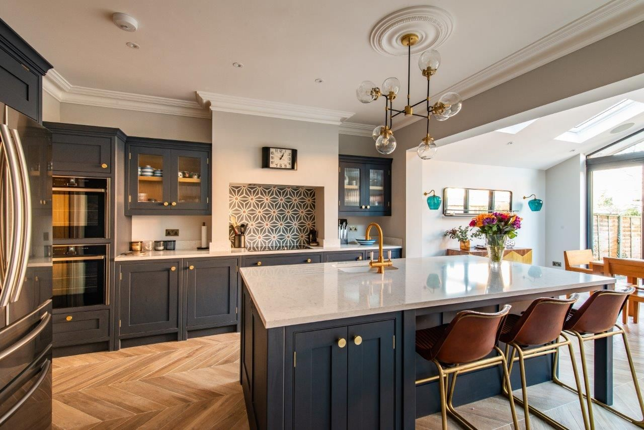 We are lucky at Herringbone Kitchens to have clients with amazing style. This bespoke kitchen extension in Surrey is hand painted in Mylands Bond Street and finished with brass handles from Armac Martin. We have had so much fun working on this project and our client now has a gorgeous space to cook, entertain and live in. #kitchenextensions