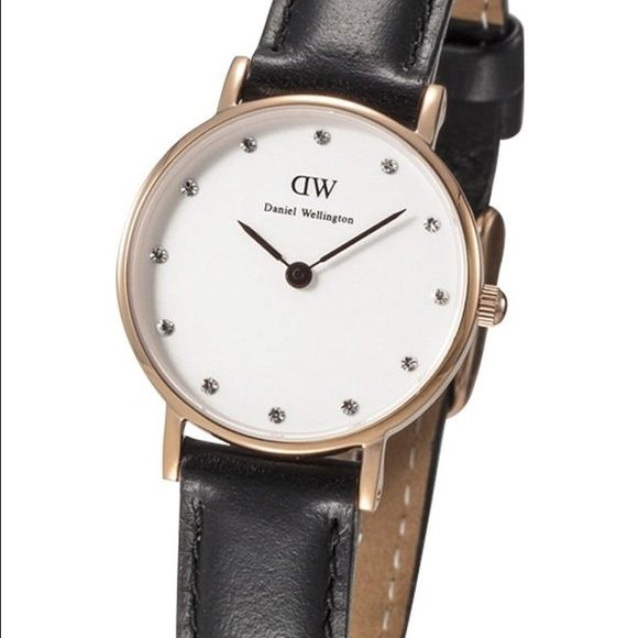 Daniel Wellington watch Brand new Inspired Daniel Wellington watch . Unisex for man and girls . NEWEST DESIGN !!! 40 mm diameter , water resistant . Gold face and black strap .Please no Trades , dont lowball me . I have a perfect rating , trusted seller and fast shipper . Very beautiful and for a great price :D happy customers happy seller Daniel Wellington Accessories Watches