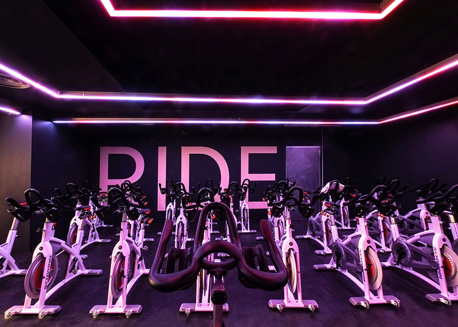 Das studio converts parisian factory into indoor cycling for Indoor cycle design
