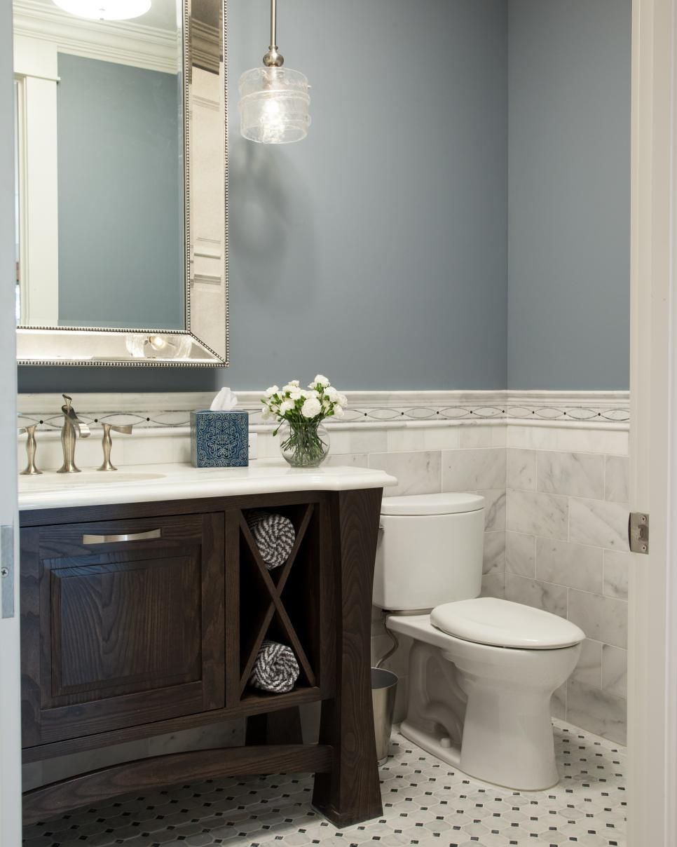 soothing blue and halfway up white tile bathroom with high end